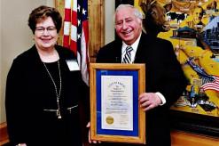 Dakhils With Award And Flag_Humanitarian